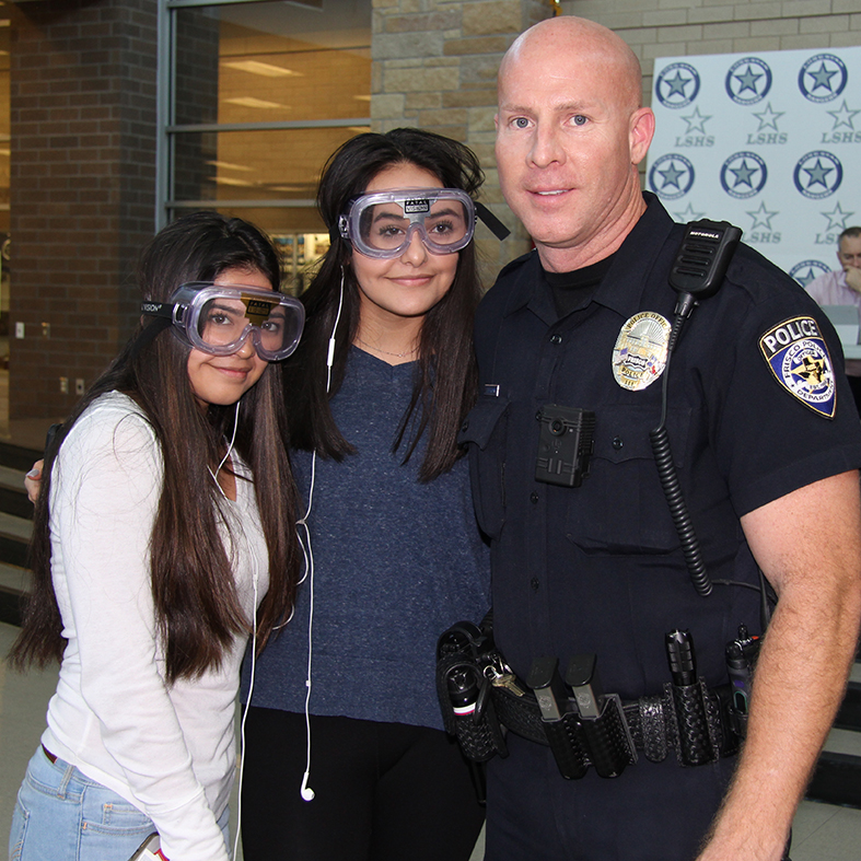 Koski Poses with Students at Lone Star High School