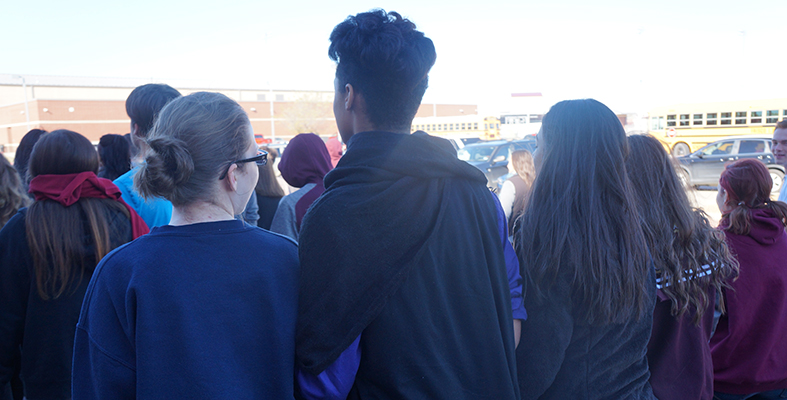 Students Walk with Arms Intertwined